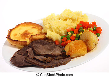 Roast beef meal angled - A plate of roast beef with mixed...