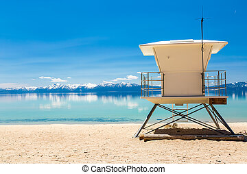 Beach on the lake with lifeguard station.