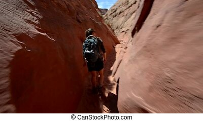 Girl Hiker Backpacker in the Slot Canyon - Woman Hiker...