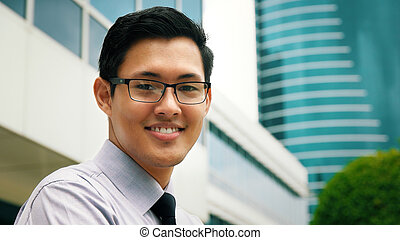 Portrait Chinese Businessman Smiling Outside Office...