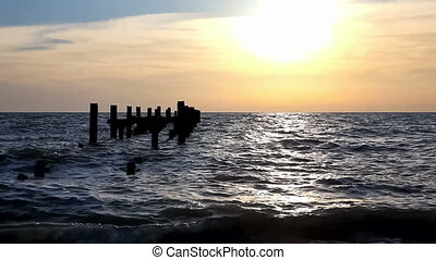 Abandoned pier at sunset