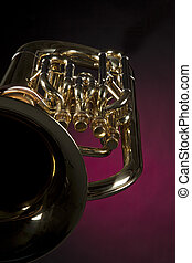 Tuba Euphonium Isolated On Red - A gold brass tuba euphonium...