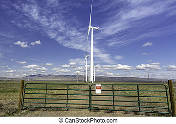 Idaho wond farm with a gated road - Gated road to a wind...