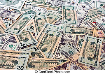 US Currency - pile of used US currency, spread out and...