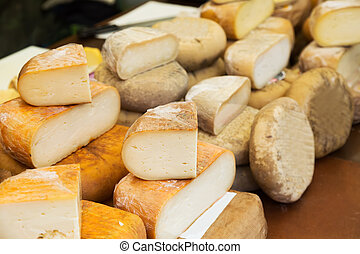 cheese at market counter - cheese in packs and in bulk at...