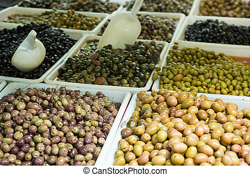 Market counter with pickled olives in Spain