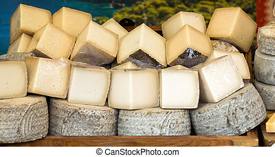 Market counter with  cheese kinds