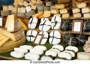 cheese at shop stand - different cheese at shop stand