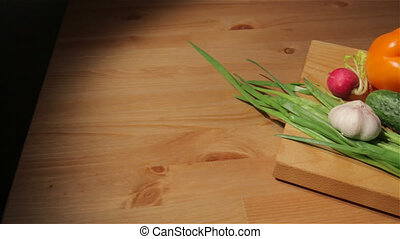 Multiple vegetables on a board - Sliding view of cucumbers,...