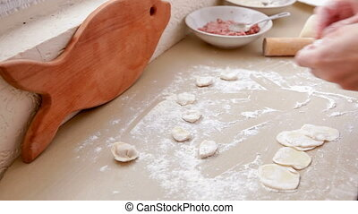 cooking ravioli - process of forming meat dumplings