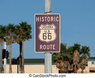 Route 66 Sign - Historic route 66 sign with palm trees in...