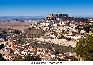 Chinchilla de Monte-Aragon with medieval castle at hill...