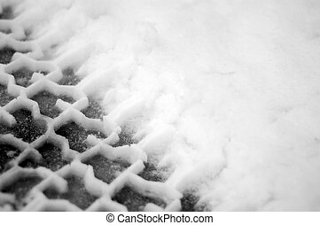 Tire tracks in snow - Black and white close up macro shot of...