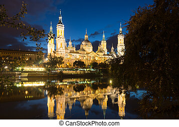 Cathedral of Our Lady of the Pillar in evening. Zaragoza