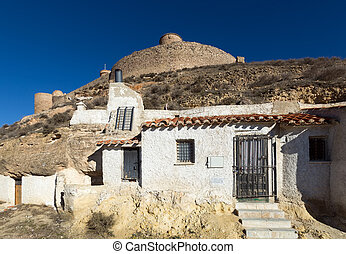 Dwelling houses into mount. Chinchilla de Monte-Aragon,...