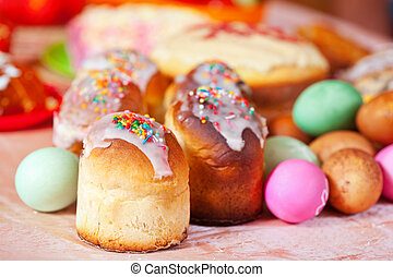 Easter cakes and eggs on festive table