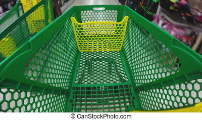 Shopping cart - Walking through the shop with green cart...