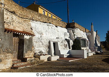 Dwellings houses-caves built into rock. Chinchilla de...