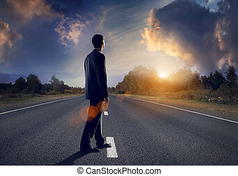Road to success - Businessman goes straight on his way on...