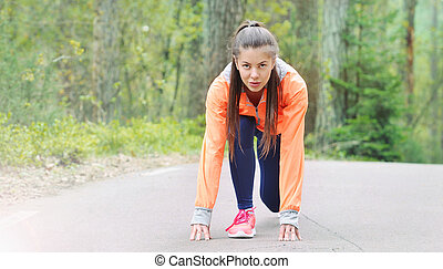 healthy lifestyle sporty woman begining run early in the...