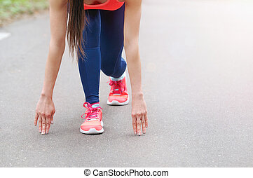 healthy lifestyle sporty woman begining run on the road -...