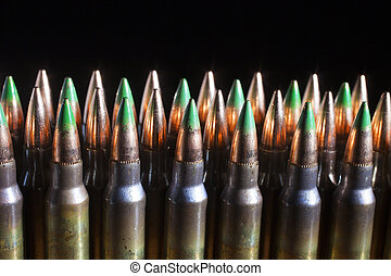 Cartridge lineup - Three rows of cartridges with some having...