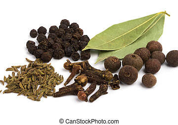 bay leafs, cloves, caraway and black pepper on white...