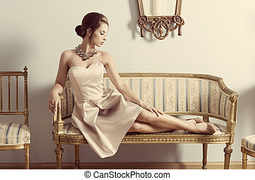 aristocratic girl on sofa - interior portrait of brunette...