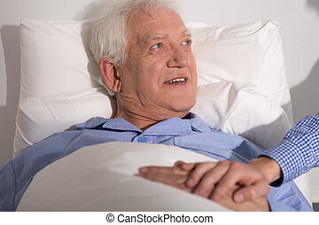 Happy man in hospital - Happy aged man having a guest in...