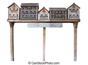 Old wooden starling nesting boxes bird house isolated over...