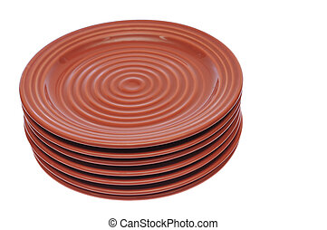 Stacked red brown plates - Seven redbrown plates stacked on...