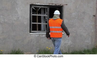 Construction inspector check broken window