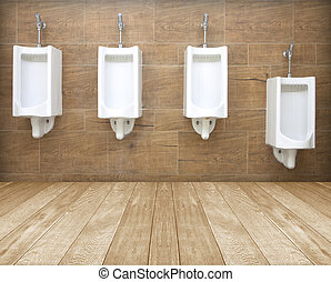 toilets background - white porcelain urinals in public...