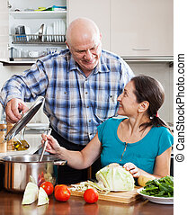 Smiling senior couple cooking together - Smiling senior...