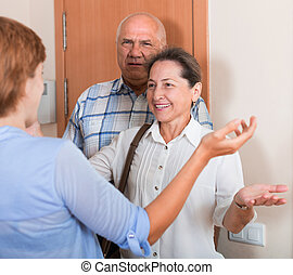 Meeting parents - Daughter greeting elderly parents at...