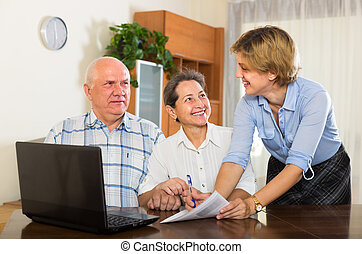 couple filling questionnaire for employee - Mature couple...
