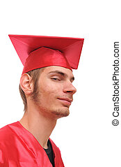 Smiling graduate student in red cap and gown