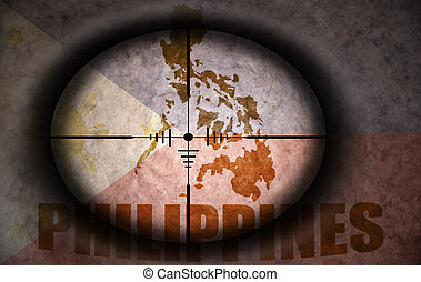 sniper scope aimed at the vintage philippines flag and map