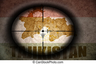 sniper scope aimed at the vintage tajikistan flag and map