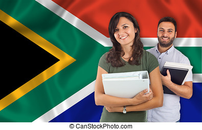 Couple of students over South Africa flag - Couple of young...