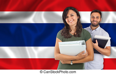 Couple of students over Thai flag - Couple of young students...