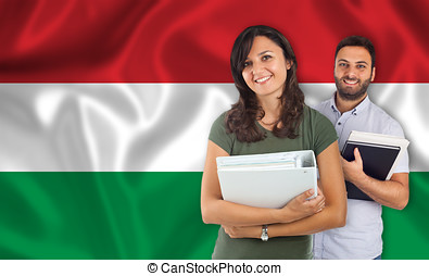 Couple of students over Hungarian flag - Couple of young...