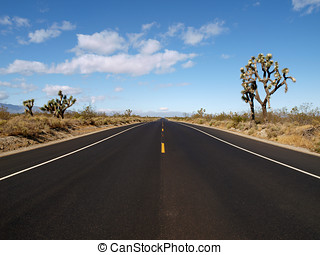 Pear Blossom Highway - Fresh pavement and Joshua Trees along...