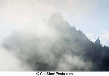 Mountain top with clouds - View on a mountain top with...