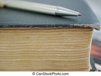 Study of the History - pen lies on a very old book, closeup