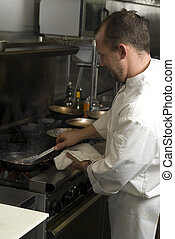 Chef cooking tuna - Caucasian chef in a smoky restaurant...