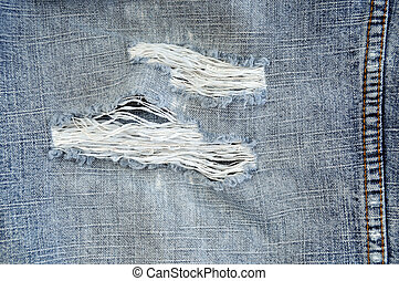 Worn out blue jeans close up