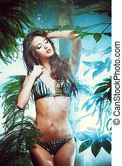jungle - Beautiful sexy woman in bikini among tropical...