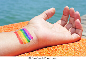 man with the rainbow flag painted in his wrist - closeup of...