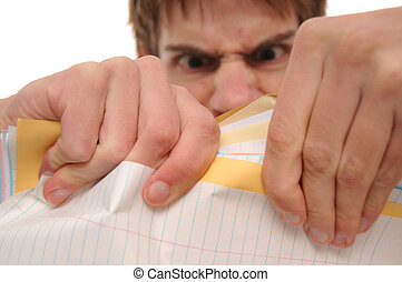 Angry young man ripping papers - Angry young man ripping...